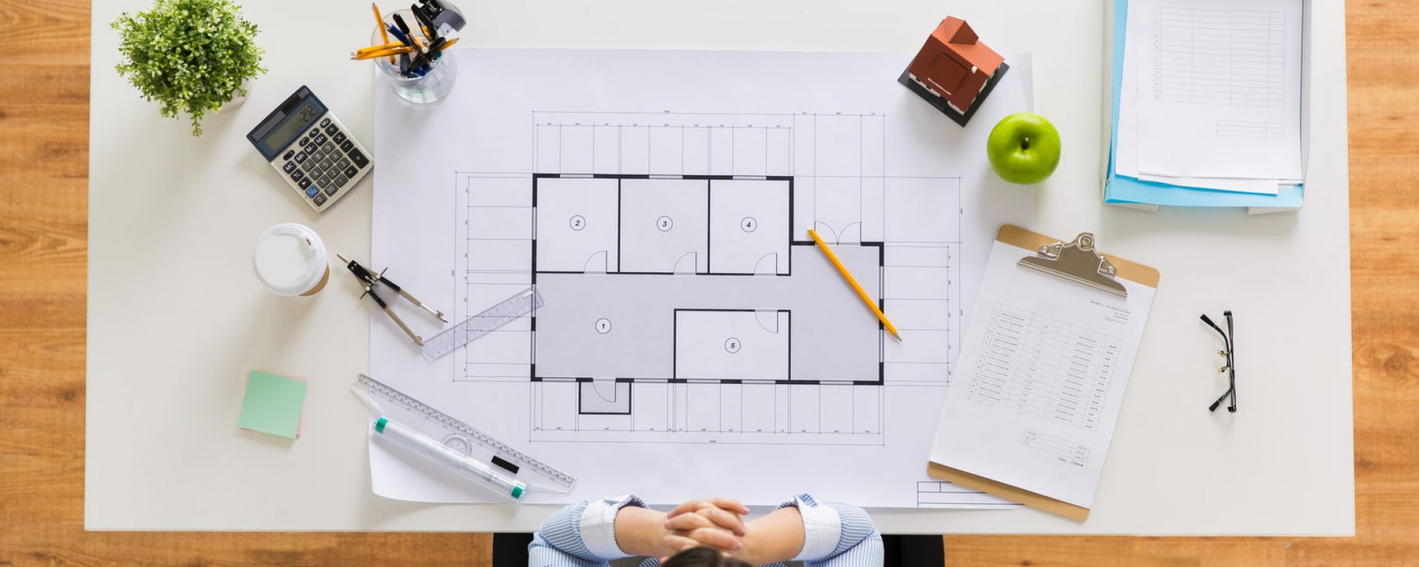 architect-with-house-blueprint-at-office-PDQRLAX-min